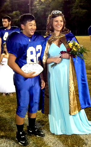 Homecoming captain Nou Thor and queen Seanna Shaw pose for a photo.