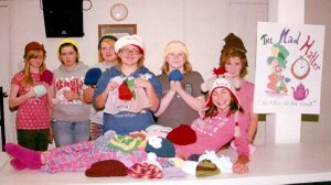 Girl Scouts enjoyed tea and a knitting party. Pictured are Brooke Smith (front), Rachel Jones (left), Christy Bramel, Trista Carey, Emily Pierce, Taylor Smith and Millie Bramel.