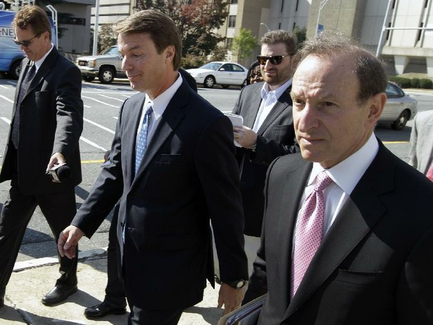 former-us-sen-and-presidential-candidate-john-edwards-center-leaves-the-federal-court-after-an-appearance-in-greensboro-nc-thursday-oct-27-2011-a-federal-judge-denied-on-thursday-a-bid-by-edwards-to-have-the-criminal-case-against-him-thrown-out-paving-the-way-for-a-trial-to-begin-in-january-ap-photochuck-burton