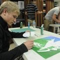 ART CLASS Nathan Worona, 18, left, and Eli Reynolds, 16, work on paintings during art class Thursday...