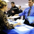 Clarence Turner of Little Canada, Minn., hands in his resume at the Minneapolis Career Fair held in ...