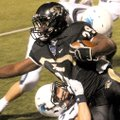STAFF PHOTO DAVID FRANK DEMPSEY -- Bentonville running back Tearris Wallace gains yards before being...