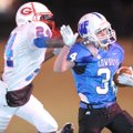 Woodland Junior High's Kyle Freeman, right, carries the ball as George Junior High's Zac Burton reac...