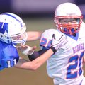 CHALLENGING THE BALL CARRIER George Junior High's Ian Crawford, right, reaches to fend off Woodland ...