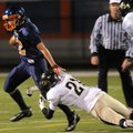 Jackson Breece of Bentonville Gold dives for Damian Gonzalez's leg Thursday during the game against ...