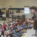 SINGING COWBOY Kyle Schoeller, Northside Elementary School music teacher, croons cowboy songs to the...