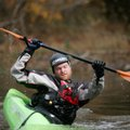Ben Hodgin of Rogers demonstrates rolling techniques in a small kayak at a previous Lincoln Lake Out...