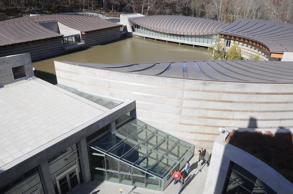 Photo by Justin Wedgworth—                                                                                        Visitors make their way Friday, Nov. 11, 2011, to the Crystal Bridges Museum of American Art in Bentonville.