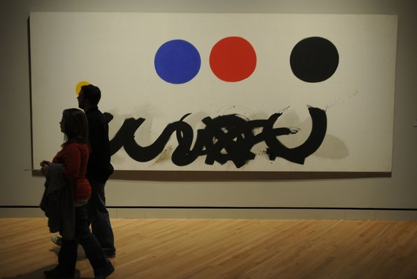 "Photo by Justin Wedgworth—                                                                                        Ben and Danielle May, of Bella Vista, walk past Adolph Gottlieb's ""Trinity"" on Friday, Nov. 11, 2011, during the opening day at the Crystal Bridges Museum of American Art in Bentonville."