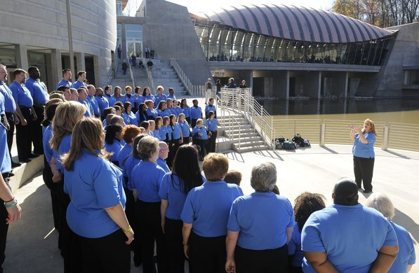 Photo by Justin Wedgworth—                                                                                        The Walmart Associate National Choir sings Friday, Nov. 11, 2011, during the opening day at the Crystal Bridges Museum of American Art in Bentonville.
