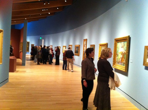 Photo by Kevin Kinder—                                                                                        The galleries are busy but not full.