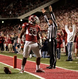 Arkansas running back Dennis Johnson scored on two touchdown runs of 71 and 15 yards Saturday at Reynolds Razorback Stadium in Fayetteville, helping the Razorbacks post a 49-7 victory over Tennessee and rise from No. 8 to No. 6 in the BCS standings.