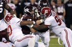 Mississippi State quarterback Tyler Russell (center) is tackled for a loss during Saturday's game against Alabama in Starkville, Miss. Russell has completed 62 of 114 passes for 979 yards and 8 touchdowns with 4 interceptions in seven games this season.