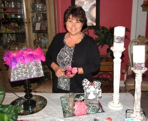 Can you spot the duct tape? Dona Young posses with some of her duct tape creations, including the lamp, picture frame, candle rings and flowers.