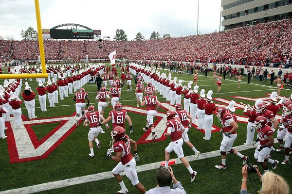 11/19/11 Arkansas Democrat-Gazette/STEPHEN B. THORNTON Arkansass Razorbacks runs out onto the field at the start of  their  game Saturday against Mississippi State at War Memorial Stadium.