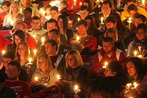 arkansas-democrat-gazettewilliam-moore-students-hold-candles-during-a-vigil-for-garrett-uekman-monday-november-21-2011-at-bud-walton-arena-in-fayetteville