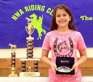 The NWA Riding Club had its end-of-the-year banquet at the Decatur Community Center, Saturday, Nov. 19. Falyn Cordeiro won first place in her age division, eight and under, for the second year in a row. She was also the overall high-point winner this year and received a trophy and belt buckle.