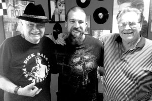 Dick Dale, left and Jack Reeves, right, with Steven Martinez, owner of the Hard Luck Cafe in Gravette.
