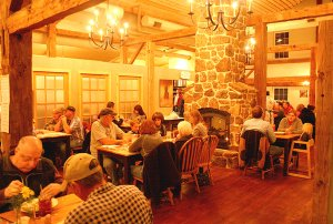 Guests enjoy an evening meal in the new Wooden Spoon Restaurant on Friday night. The new facility is built around a pre-1870 barn moved to Gentry from Michigan.
