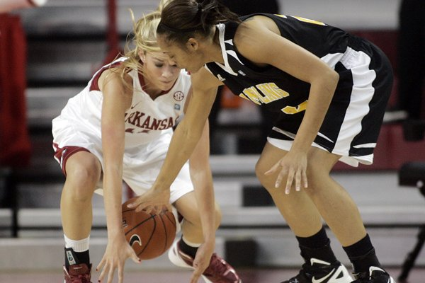 Calli Berna of Arkansas steals the ball from Grambling State's Tonishea Mack Friday at Bud Walton Arena in Fayetteville.