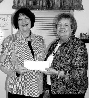 State Representative Mary Lou Slinkard, left, presents the check to Mary Kay Kelley.