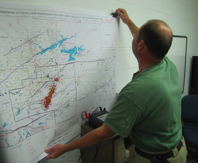 arkansas-geological-survey-geohazards-supervisor-scott-ausbrooks-puts-up-a-map-showing-the-location-of-earthquakes-in-central-arkansas-in-recent-months-during-a-recent-interview-at-his-little-rock-office