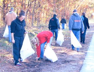 Katlynn Martin and Brooke Belts pick up trash at the Mt. Pleasant Cemetery.
