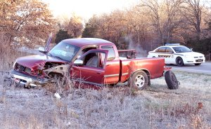 A wrecked Toyota pickup truck sets along the highway following a three-vehicle accident on Nov. 30. All three drivers were taken to the hospital following the crash.