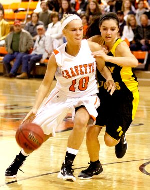 Gravette senior Shyanne Nichols moves the ball past a Prairie Grove defender during play on Friday.