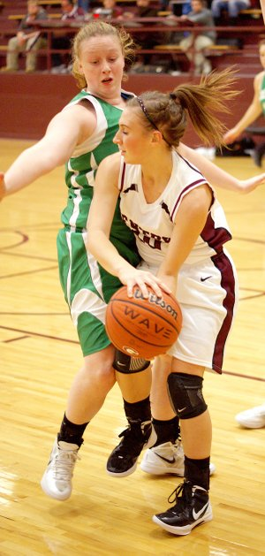 Kaylin Cripps looks for room to move the ball against a tough Greenland defense in play at Gentry High School on Dec. 6.