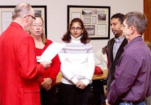 Lions Club district governor Ken Swanson inducts new Gentry club members Margaret Lynch, Pragya Mathur, Dr. Ashish Mathur and Robert Lynch.