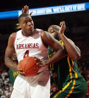 Arkansas Democrat-Gazette/WILLIAM MOORE -- Arkansas' Devonta Abron works against Southeastern Louisiana State's Elgin Bailey Saturday, Dec. 17, 2011 at Bud Walton Arena in Fayetteville.