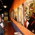 Jo Barnes from Rogers looks at part of a series of abstract paintings of American presidents by Cind...
