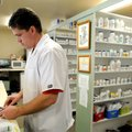 Jon Ragan, pharmacist at HealthMart Pharmacy, fills a prescription at the business Tuesday in Spring...