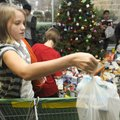 Baleigh Birdcreek, a sixth-grade students at Lingle Middle School in Rogers, loads a shopping cart w...