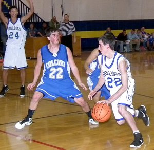 Trey Kell drove down the court during the Dec. 12 game against the Colcord (Okla.) Hornets. Decatur lost the game 48-42 in overtime.