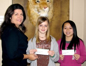 Austina Lee, right, won first place in the Bella Vista VFW Democracy essay contest in competition with students from Bentonville/Gravette middle schools. Third place was won by Tiffany May. Presenting checks to the winners was Brenda Yates, representing the Kiwanis Club which sponsors the Middle School Builder's Club.