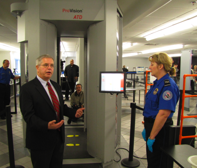 tsa-federal-security-director-jerry-henderson-left-talks-about-the-new-advanced-imaging-technology-screening-device-behind-him-during-a-news-conference-friday-at-little-rock-national-airport