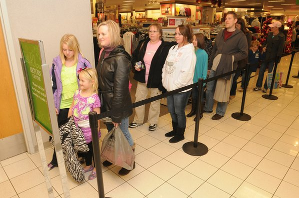 a line of gift exchangers forms at the customers service desk monday at kohls department store in rogers after christmas sales and gift exchanges made the