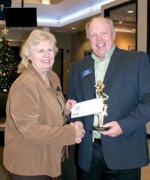 Sherry DuBois presents check to Jim Singleton.