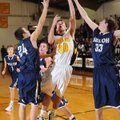 Prairie Grove's Marcus Patterson, center, leaps to score in the lane as Shiloh Christian's Darian Ha...