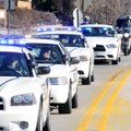 "Sixty-three law enforcement vehicles from agencies around Northwest Arkansas participate in a ""blue ..."