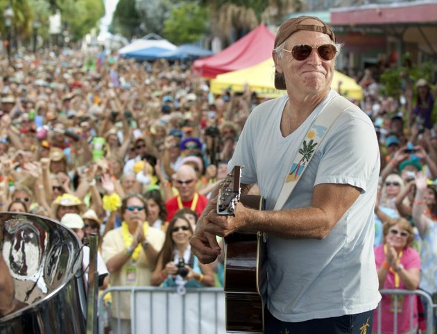 in-this-friday-nov-4-2011-photo-provided-by-the-florida-keys-news-bureau-singersongwriter-jimmy-buffett-performs-before-some-3500-of-his-fans-on-duval-street-in-key-west-fla-attendees-at-the-20th-parrot-heads-convention-were-surprised-when-buffett-made-a-rare-appearance-playing-with-his-coral-reefer-band-for-more-than-an-hour