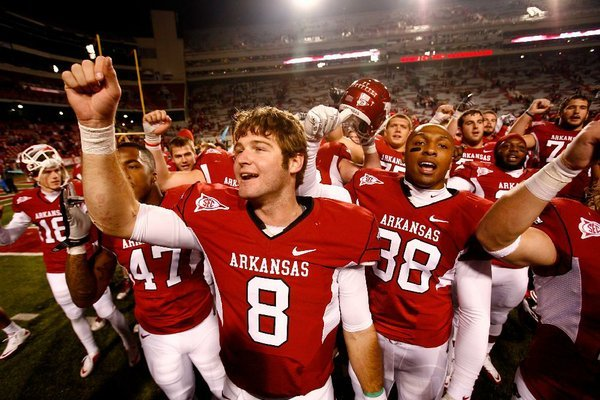"""Who doesn't want to play on a top-10 stage with something to prove?"" Arkansas quarterback Tyler Wilson asked. Wilson is seen here with his teammates singing the fight song."