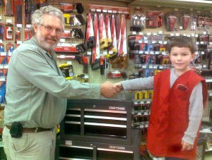 David Nelson shakes hands with Joseph Bever (future owner/operator) of Bever's Ace Hardware.