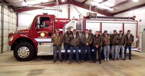The Decatur Fire Department received a new pumper truck, purchased by Benton County. Firefighters posed with the truck at their Jan. 3 meeting.