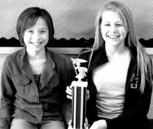 Jillian Brown, first place in the GMS spelling bee with runner-up A.J. Claborn.