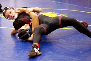 Waiting for the Call — Gentry junior Tyler Easter holds his opponent in position for a fall and waits for the call during wrestling action in Gentry on Saturday.