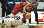 Arkansas guard B.J. Young and Mississippi's Reginald Buckner go for a loose ball on Wednesday in Oxford, Miss.