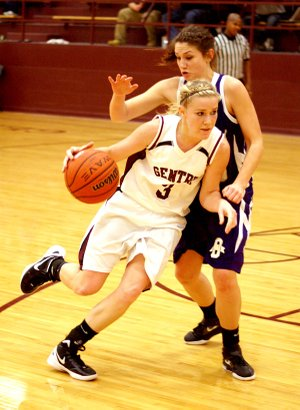 Gentry junior Tara Arnold dribbles around an Ozark player during the Jan. 10 homegame in the Pioneer gymnasium.
